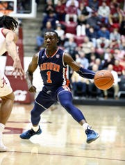 Auburn guard Jared Harper (1) dribbles past an Alabama defender on March 5, 2019, in Tuscaloosa, Ala.