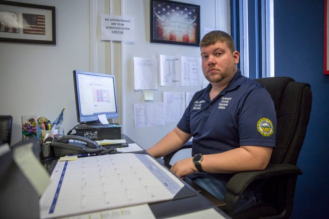 Devin Hamilton, a work study with the Delaware County Veteran's Affairs office, works at his desk on Tuesday at the county government complex. The office utilizes three full-time employees from the county and twelve work study participants funded by the VA to assist local veterans.