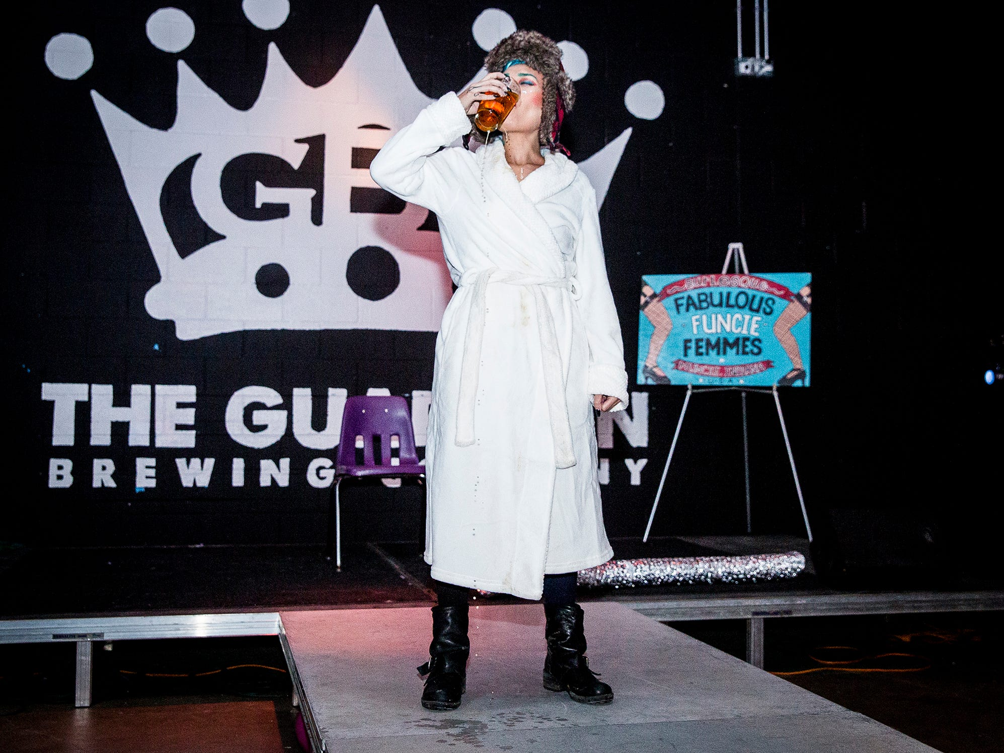 Greta Glee performs a Christmas Vacation themed burlesque at the Mark III Taproom.