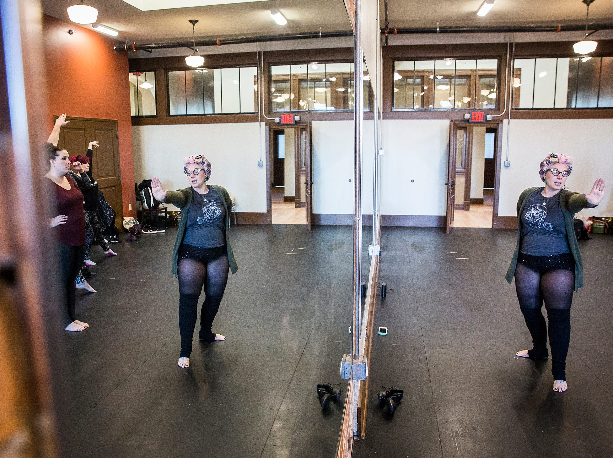 Stephanie Hutchison leads the Fabulous Funcie Femmes burlesque troupe in a practice session at the Muncie Civic Theatre.