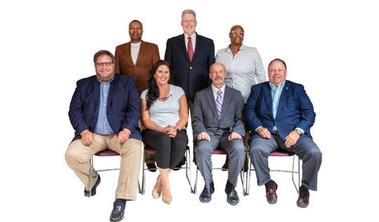 Muncie school board members (front l-r) James Williams, Brittany Bales, Jim Lowe, and Dave Heeter; (back l-r) Keith O'Neal, Mark Ervin, and WaTasha Barnes Griffin