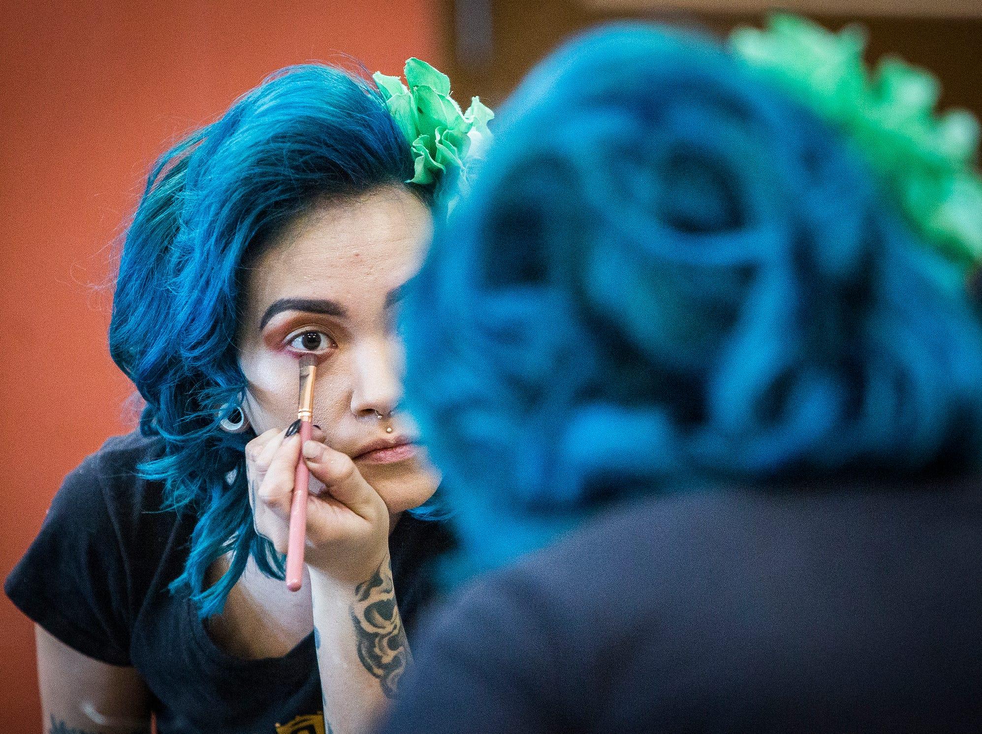 Greta Glee applies makeup at the Muncie Civic Theatre.