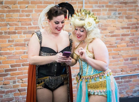 Minx Le Mew (left) and Margot Lugosi of the Fabulous Funcie Femmes review a selfie during practice at the Muncie Civic Theatre.