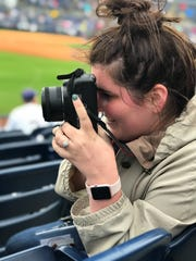 Aryn McNamara takes photos inside an MLB stadium during her Ball State University immersive learning program.