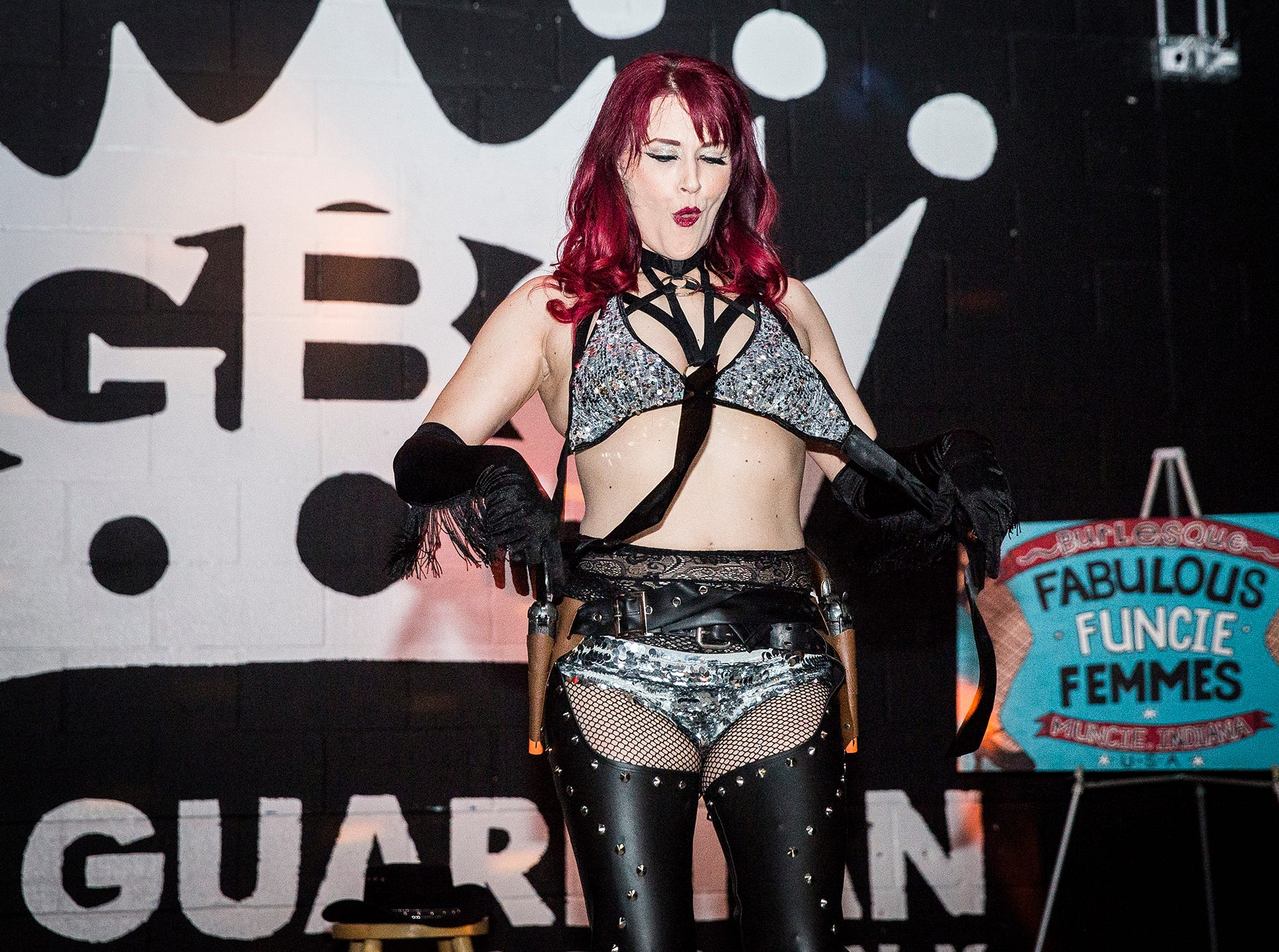 Jamie Prang performs a routine at The Guardian. Prang, who was diagnosed with MS, organizes the annual Fabulous Funcie Femmes Orange Masquerade Ball.