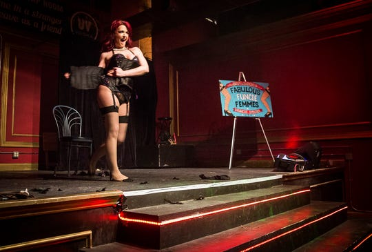 Jamie Prang performs a routine at the Mark III Taproom. Prang, who was diagnosed with MS, organizes the annual Fabulous Funcie Femmes Orange Masquerade Ball.
