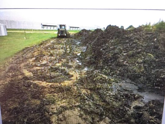 State officials say runoff from this compost pile of carcasses caused a fish kill last fall near Union City