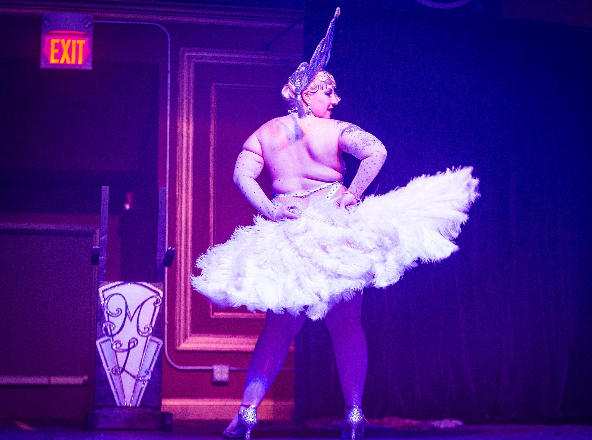 Stephanie Hutchison, AKA Margot Lugosi, founder of the Fabulous Funcie Femmes, performs a fan dance during her routine at the Mark III Taproom.