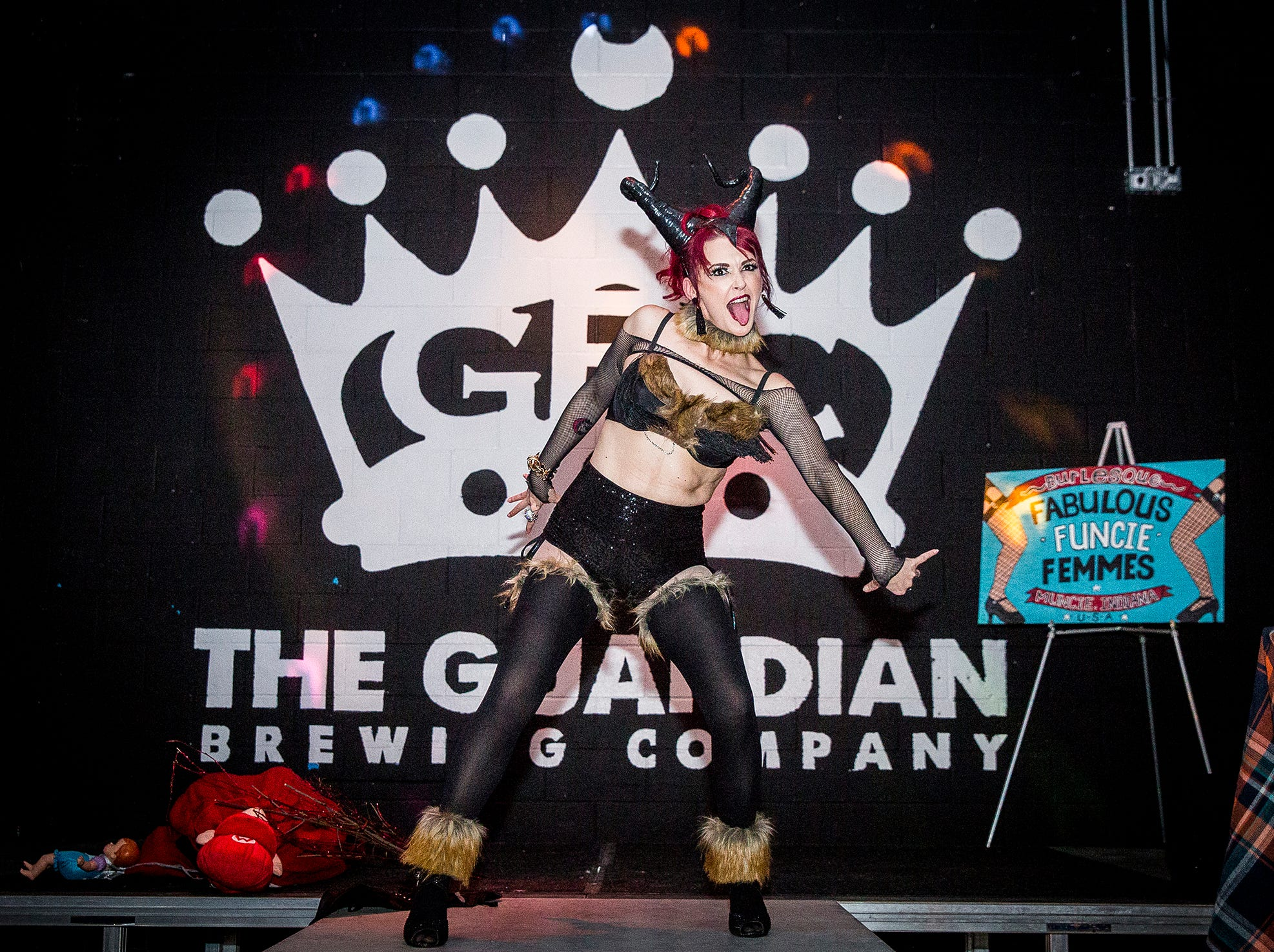 Jamie Prang performs a Krampus-themed burlesque at the Mark III Taproom.