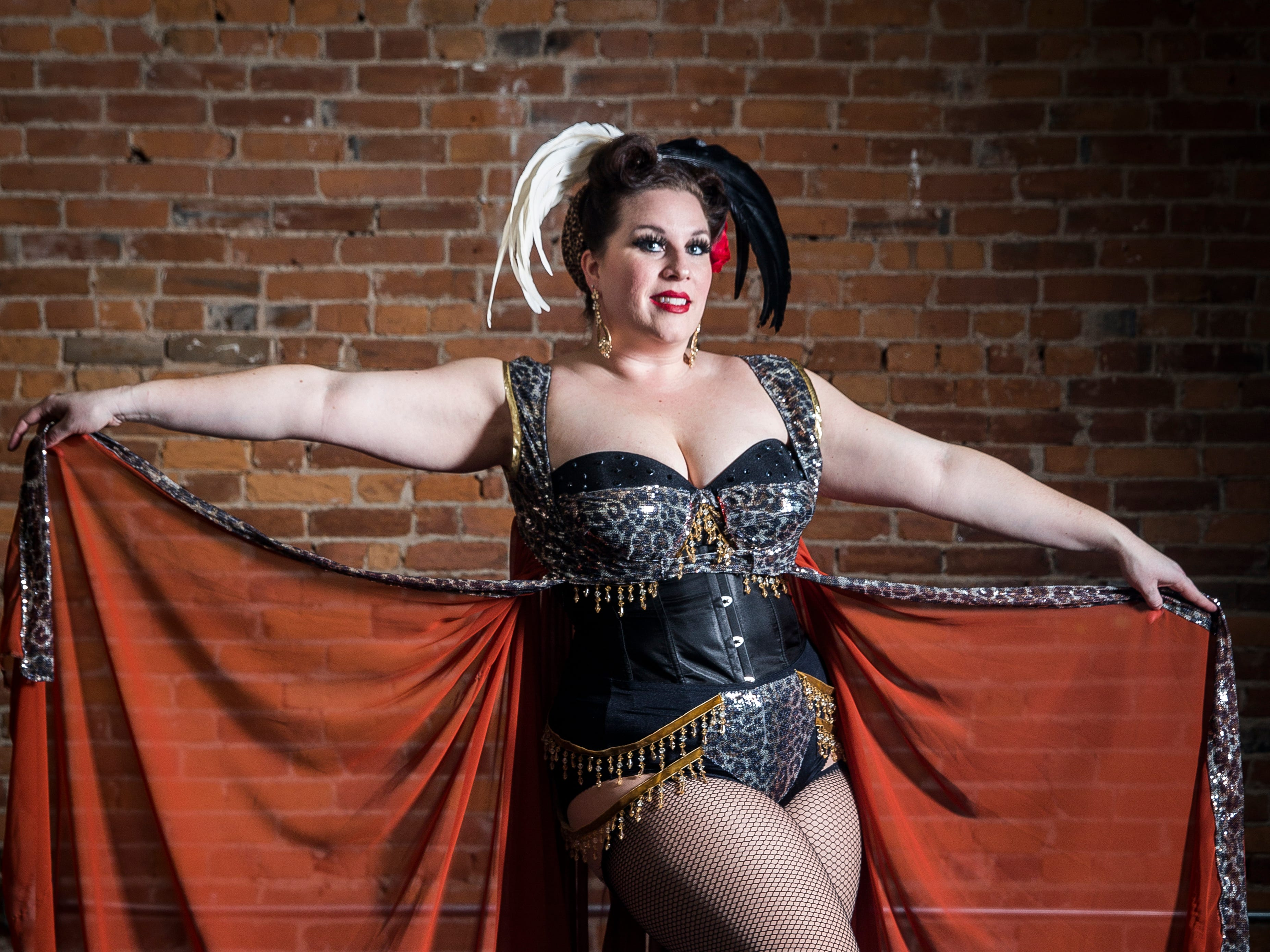 Fabulous Funcie Femmes performer Minx Le Mew in and out of character.