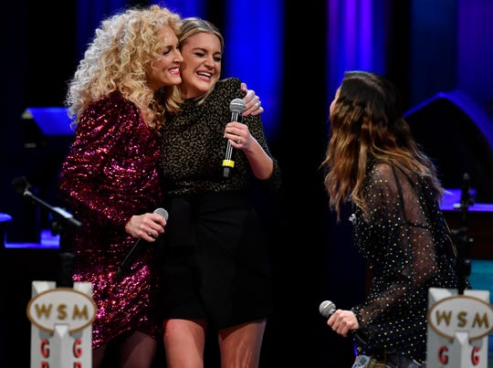 Kelsea Ballerini is hugged by Kimberly Schlapman of Little Big Town after she accepted her invitation to join the Grand Ole Opry Tuesday, March 5, 2019 in Nashville, Tenn.