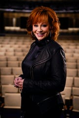 Reba McEntire poses for a portrait at the Country Music Hall of Fame Tuesday, March 5, 2019 in Nashville, Tenn. McEntire is releasing a new album, hosting the ACM Awards for the 16th time and is part of a new exhibit at the Country Music Hall of Fame.