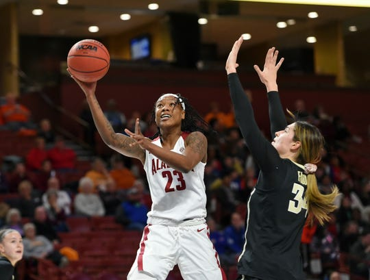Alabama's Shaquera Wade (23) shoots while defended by Vanderbilt's Mariella Fasoula during the first half of a women's SEC tournament game Wednesday.
