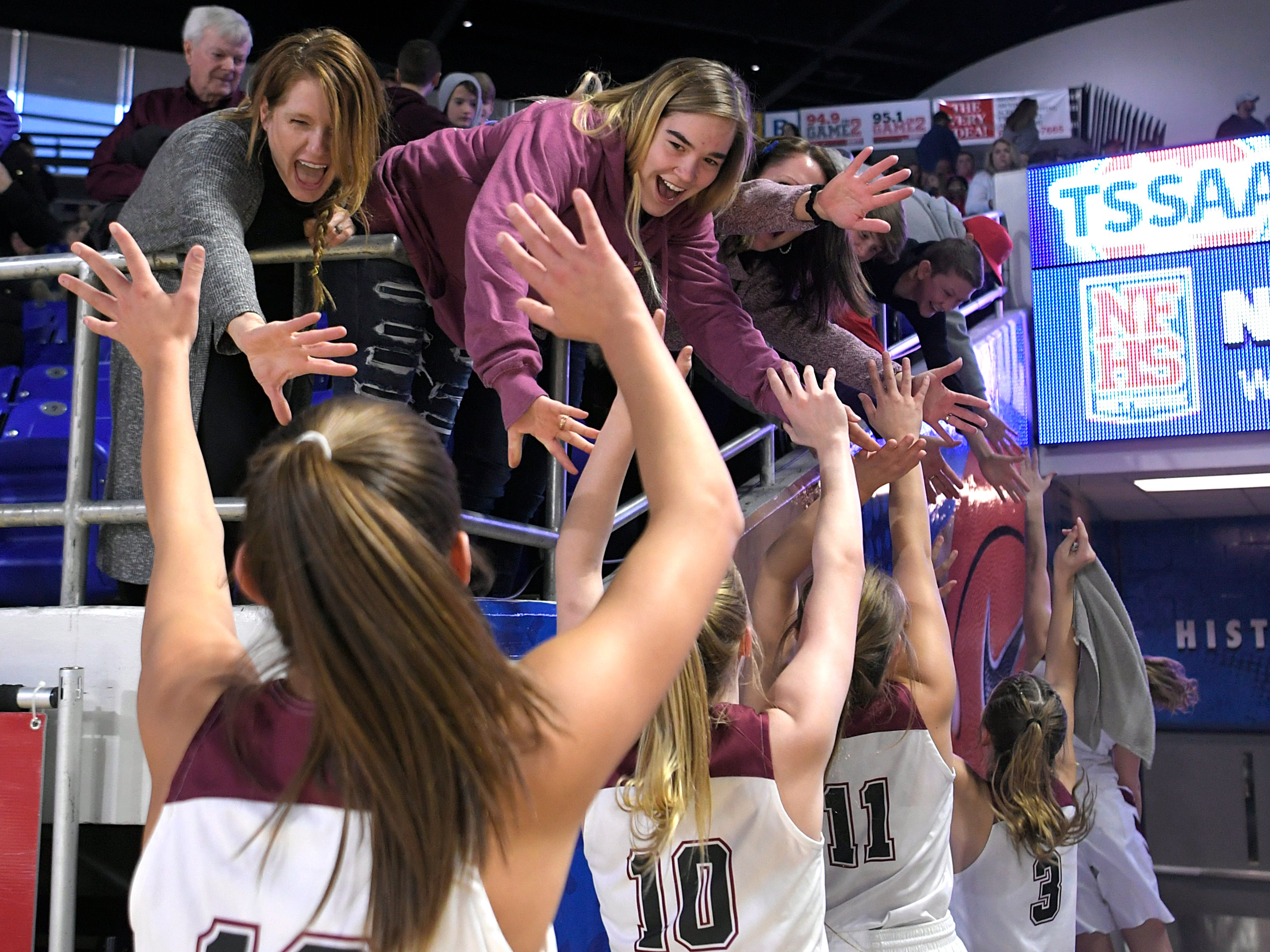 Cheatham County fans cheer on players after beating Grainger during the quarter finals of TSSAA BlueCross Class AA girls basketball championship at MTSU's Murphy Center in Murfreesboro on Wednesday, March 6, 2019.