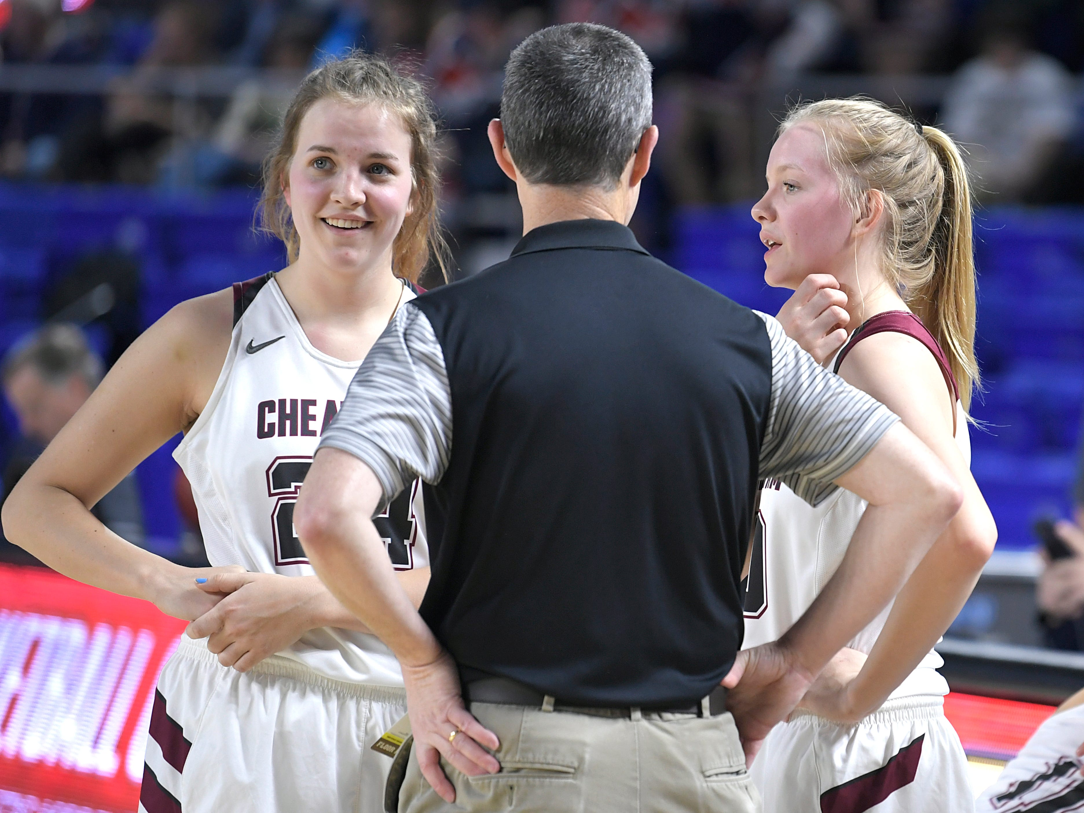 Cheatham County's Alli Douglas (24) and Abbi Douglas (10) talk with head coach Jim Gibbs during half time during the quarter final game at the  TSSAA BlueCross Class AA girls basketball championship at MTSU's Murphy Center in Murfreesboro on Wednesday, March 6, 2019.