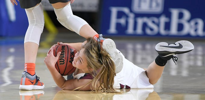 Cheatham County's Jesse Bumpus (11) falls on the floor to save the ball during a game against Grainger at the quarter finals of TSSAA BlueCross Class AA girls basketball championship at MTSU's Murphy Center in Murfreesboro on Wednesday, March 6, 2019.