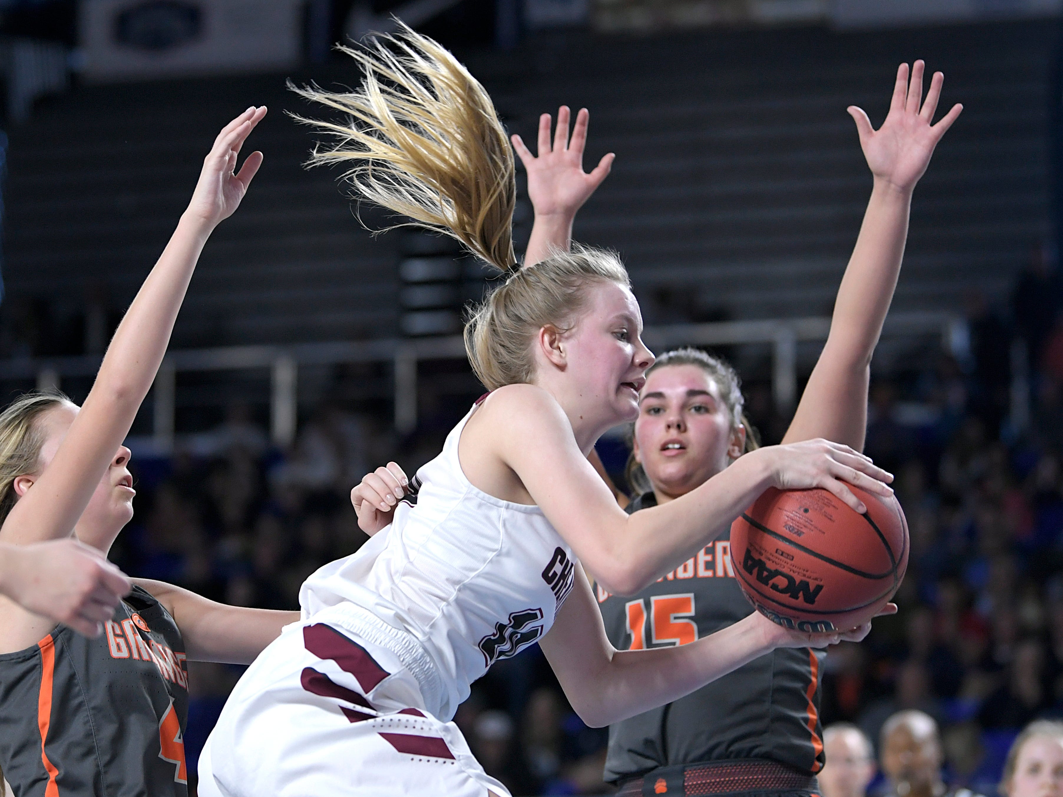 Cheatham County's Abbi Douglas (10) drives to the basket against Grainger's Matty Turner (4) and Abbey Hodge (15) during the quarter finals of TSSAA BlueCross Class AA girls basketball championship at MTSU's Murphy Center in Murfreesboro on Wednesday, March 6, 2019.