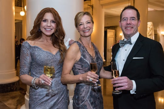 Amy Atkinson, left, Dallas Wilt and Amos Gott attend the 30th anniversary Ballet Ball at Schermerhorn Symphony Center.
