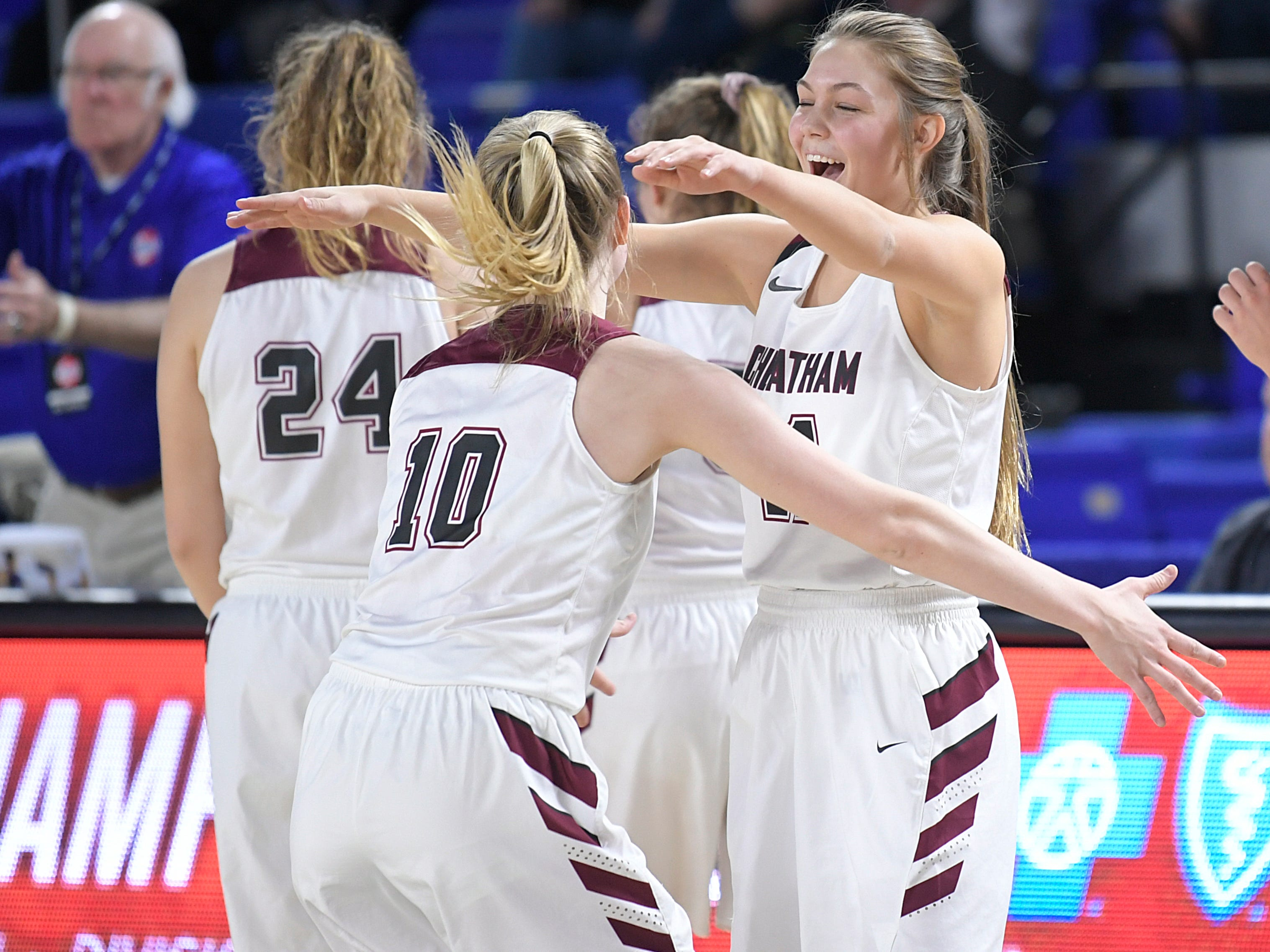 Cheatham County players celebrate after beating Grainger during the quarter finals of TSSAA BlueCross Class AA girls basketball championship at MTSU's Murphy Center in Murfreesboro on Wednesday, March 6, 2019.