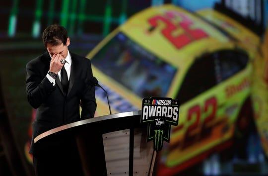 Joey Logano chokes up during the NASCAR auto racing awards ceremony Thursday, Nov. 29, 2018, in Las Vegas.