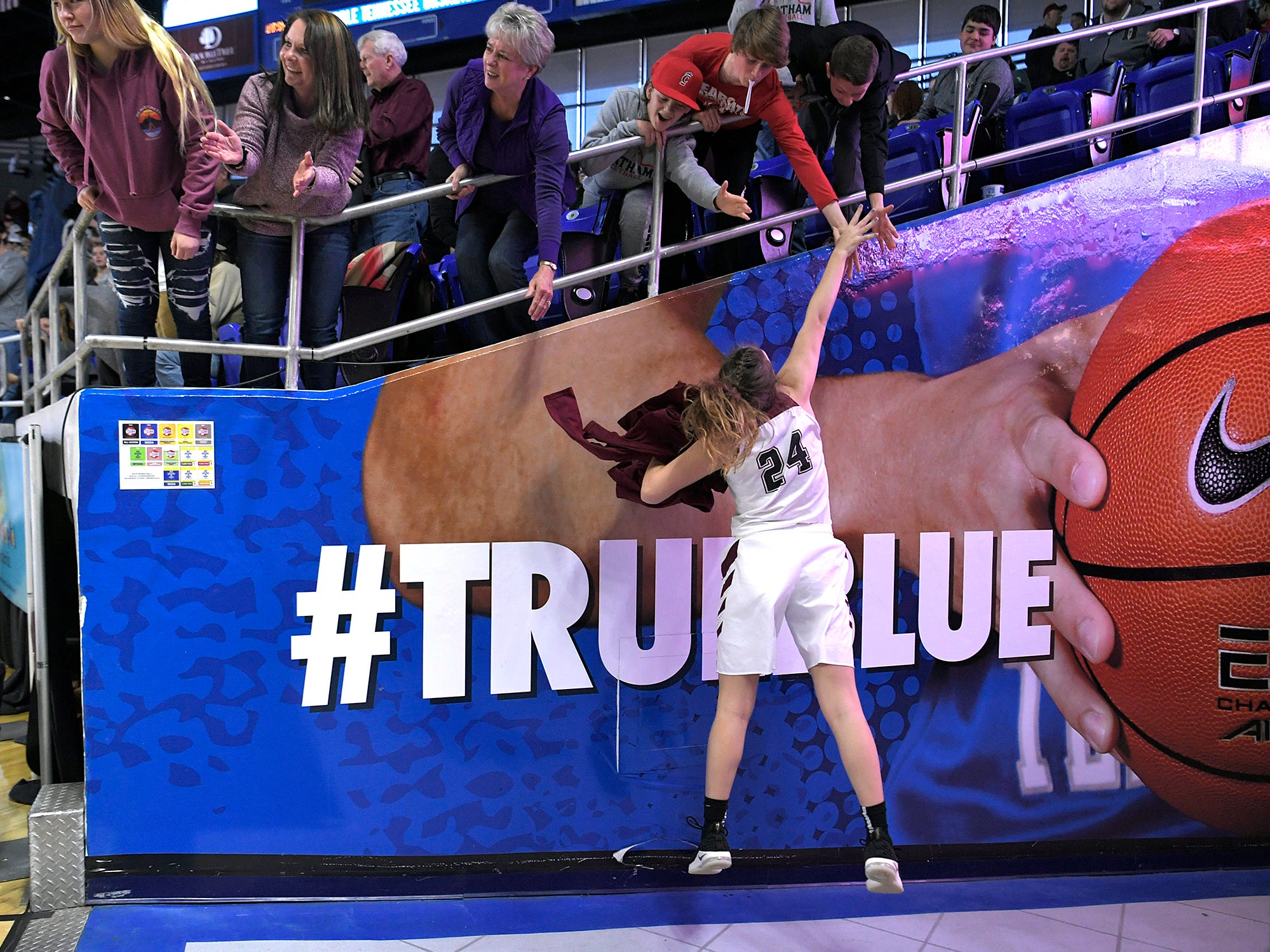 Cheatham County's Alli Douglas (24) high fives fans after beating Grainger during the quarter finals of TSSAA BlueCross Class AA girls basketball championship at MTSU's Murphy Center in Murfreesboro on Wednesday, March 6, 2019.