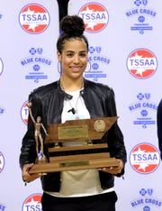 Madison Hayes of East Hamilton High School is presented the Class AAA Miss Basketball trophy, on Tuesday, March 5, 2019, at Murphy Center in Murfreesboro, Tenn.