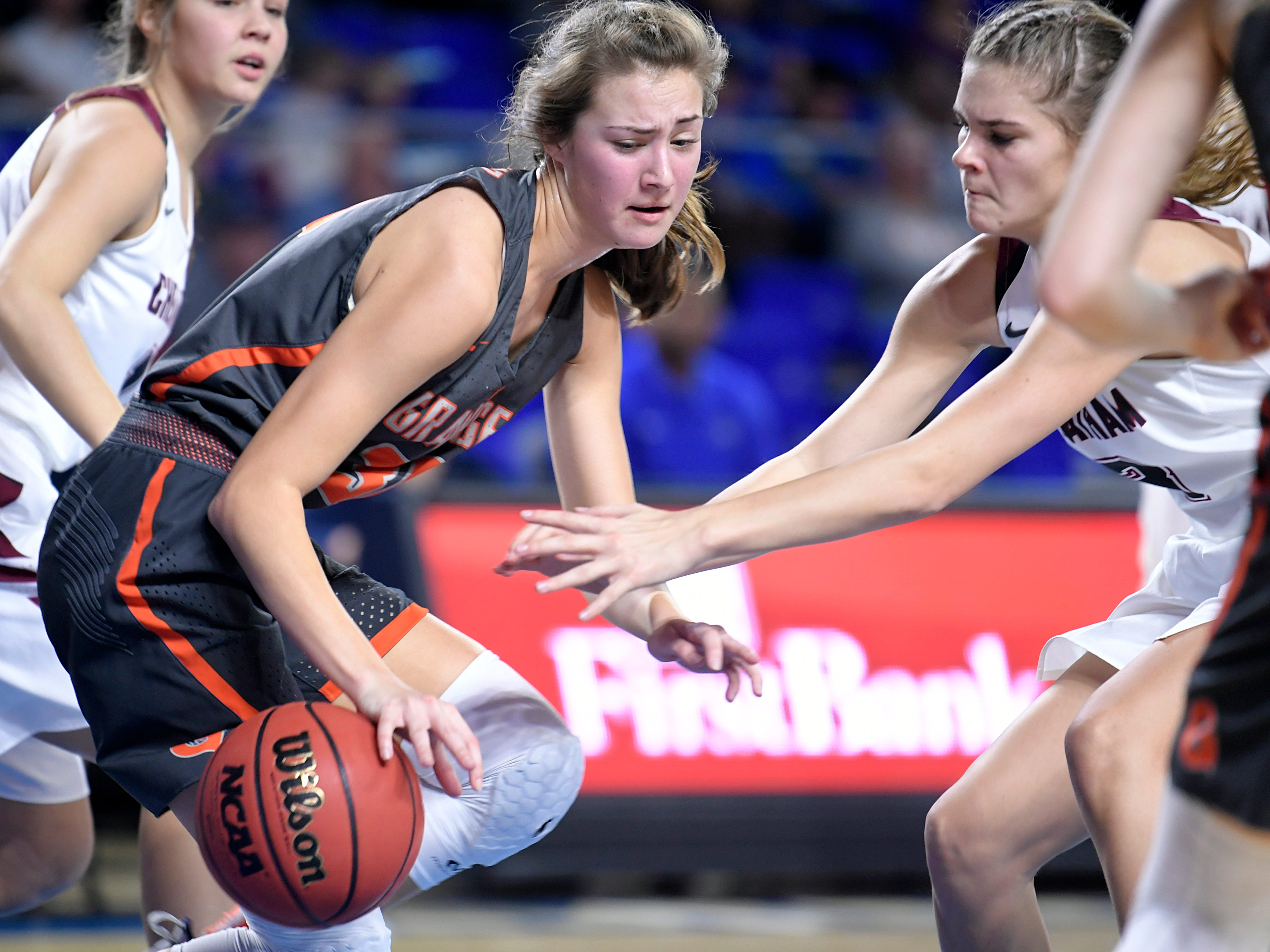 Grainger's Lauren Longmire (30) rebounds the ball against Cheatham County players during the quarter finals of TSSAA BlueCross Class AA girls basketball championship at MTSU's Murphy Center in Murfreesboro on Wednesday, March 6, 2019.