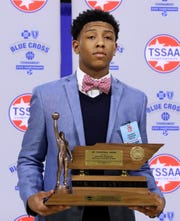 Kennedy Chandler of Briarcrest Christian School is presented the Division II Class AA Mr. Basketball trophy, on Tuesday, March 5, 2019, at Murphy Center in Murfreesboro, Tenn.