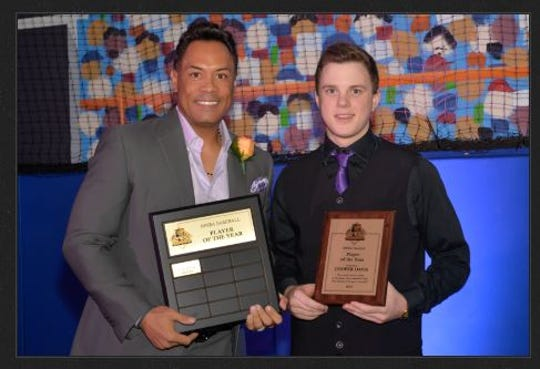 Vanderbilt baseball player Cooper Davis, then a high school player in Ontario, poses with former Toronto Blue Jays star Roberto Alomar, a Hall of Fame inductee.