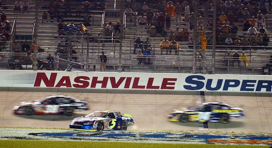After leading much of the race after the restart, Kyle Busch (5) spins down the front lane at Nashville Superspeedway with just a few laps to go, raising the last yellow flag that gave Jason Leffler the victory in June 2004.