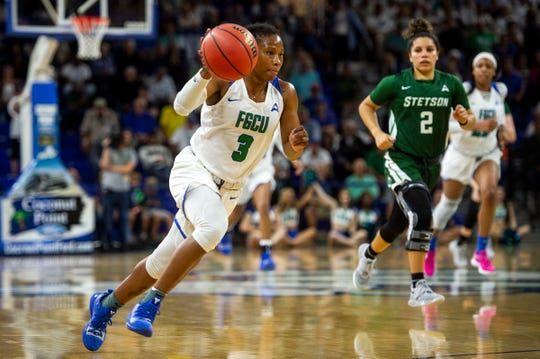 Florida Gulf Coast University's Keri Jewett-Giles, a Dunbar graduate, brings the ball up court during a game against Stetson at Alico Arena on Tuesday.