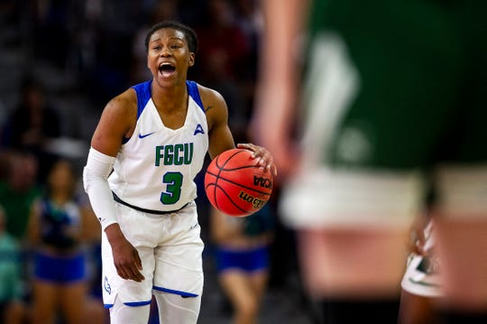 Florida Gulf Coast University's Keri Jewett-Giles shouts out a play during a game against Stetson at Alico Arena on Tuesday.