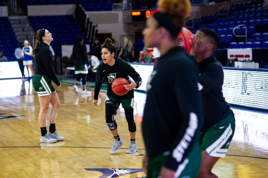 Stetson's McKenna Beach, a Cape Coral graduate, warms up before a game against FGCU at Alico Arena in Fort Myers, Fla., on Tuesday, March 5, 2019.