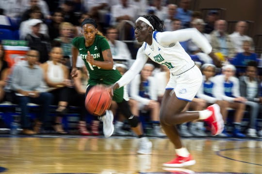 Florida Gulf Coast University's Nasrin Ulel brings the ball up the court during a game against Stetson at Alico Arena on March 5.