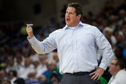 Florida Gulf Coast University head coach Karl Smesko coaches from the sidelines during a game against Stetson at Alico Arena on Tuesday.