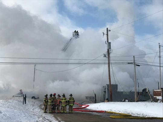 Firefighters battle a blaze at the Reclaimed Barnwood Co. on the morning of March 6, 2019.