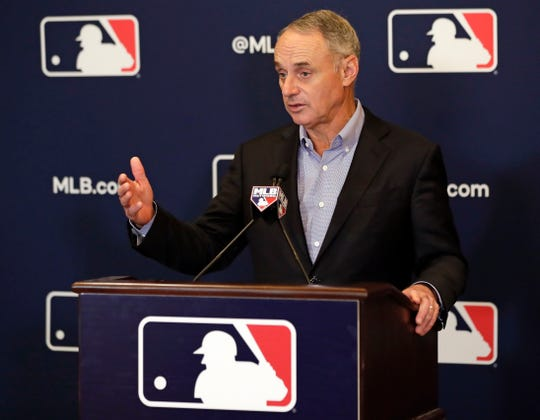 File-This Feb. 8, 2019, file photo shows Rob Manfred, commissioner of Major League Baseball, speaking during a news conference at owners meetings in Orlando, Fla. Major League Baseball and the players' union are near an agreement to expand active rosters by one to 26 starting in 2020 as part of a deal that would include a commitment to discuss larger economic issues after opening day.