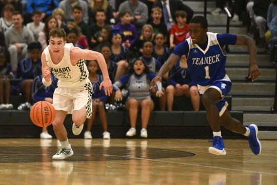 Ramapo High School defeated Teaneck High School 65-40 in the NJSIAA North 1, Group 3 boys basketball final on Tuesday, March 5, 2019 in Franklin Lakes. Kyle Hroncich #23 and Vernon Johnson #1 rush toward a loose ball.
