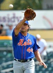 Mar 5, 2019; Jupiter, FL, USA; New York Mets starting pitcher Jason Vargas (44) revives a baseball during a game against  the Miami Marlins at Roger Dean Chevrolet Stadium.