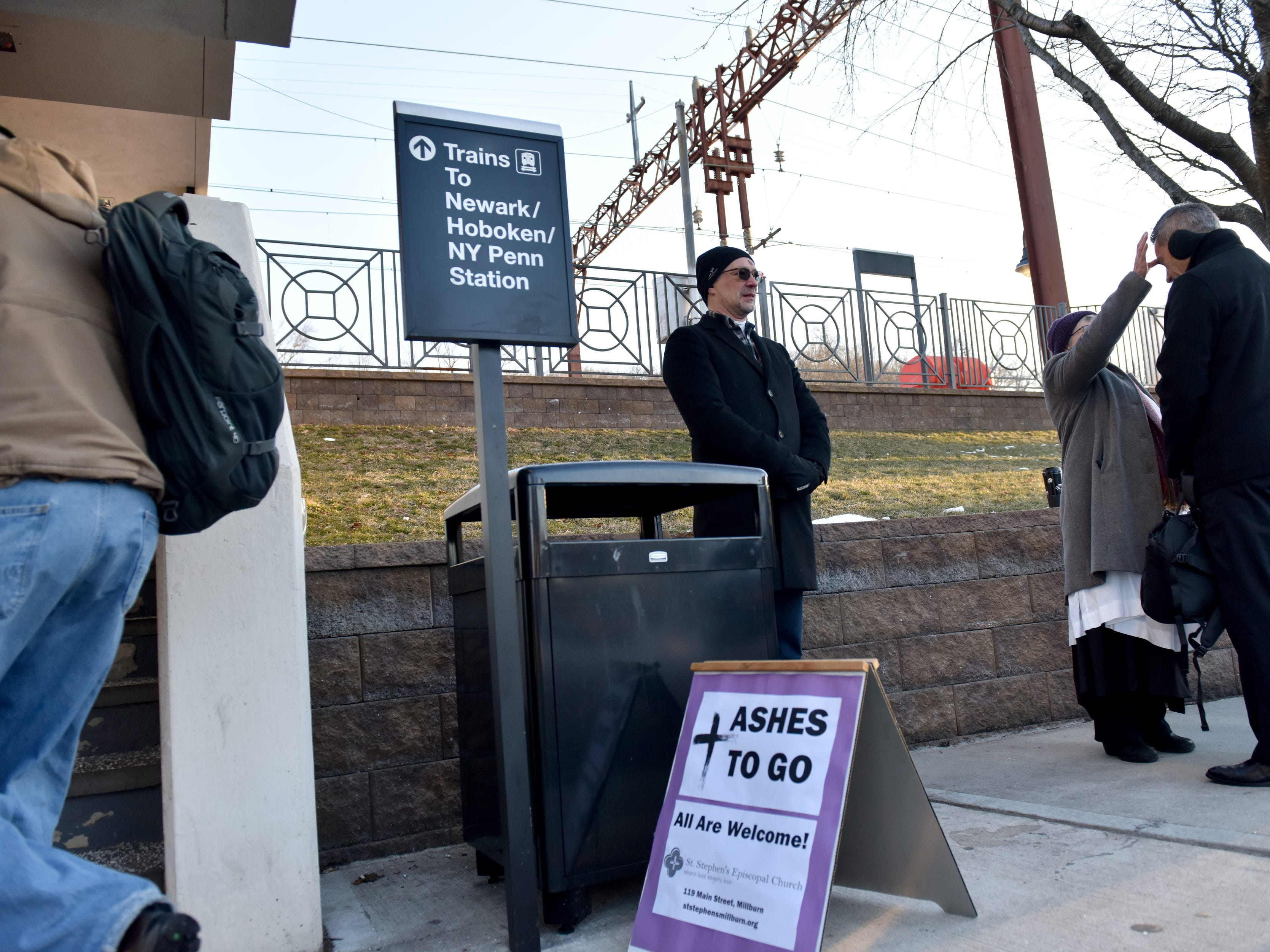 Rev. Paula J. Toland, of St. Stephen's Episcopal Church, provides Ashes at the Millburn Train Station for commuters in Millburn on Wednesday March 6, 2019.