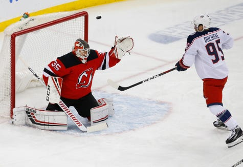 Mar 5, 2019; Newark, NJ, USA; New Jersey Devils goaltender Cory Schneider (35) defends against Columbus Blue Jackets center Matt Duchene (95) during the first period at Prudential Center.
