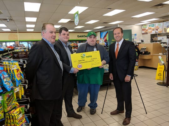 L-R) QuickChek Senior Vice President Mike Murphy, District Leader Matt Murphy and Store Leader John Rakowski were presented with a ceremonial check for $30,000 from James Carey, the New Jersey Lottery's acting executive director, at the QuickChek fresh convenience market in Phillipsburg, NJ on Tuesday, March 5. The check represents the bonus commission the store receives for selling the winning $273 million Mega Millions jackpot ticket from the Friday, March 1st drawing.