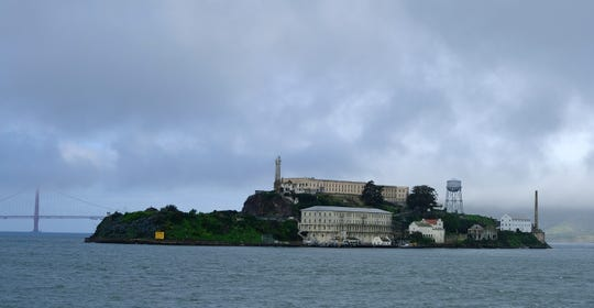 Alcatraz Island is seen Wednesday, March 6, 2019, in San Francisco. Archaeologists have confirmed a long-time suspicion of historians: the famed Alcatraz prison was built over a Civil War-era military fortification. SFGate reports researchers have found a series of buildings and tunnels under the prison yard of Alcatraz Federal Penitentiary, which once held Al Capone. (AP Photo/Eric Risberg)