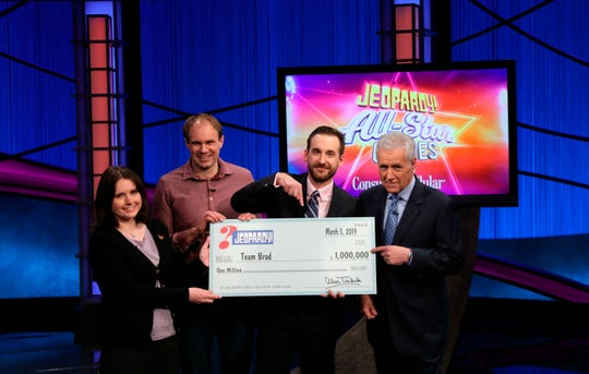 "This photo provided by Sony shows Brad Rutter, Larissa Kelly and David Madden with host Alex Trebek in Burbank, Calif. They were winners of the first-ever ""Jeopardy!"" team championship, with the final airing Tuesday, March 5, 2019. With $1 million at stake, a big Daily Double bet by Rutter positioned his team for a runaway victory as the quiz show's ""All-Star Games"" ended Tuesday. The teammates split the top prize."