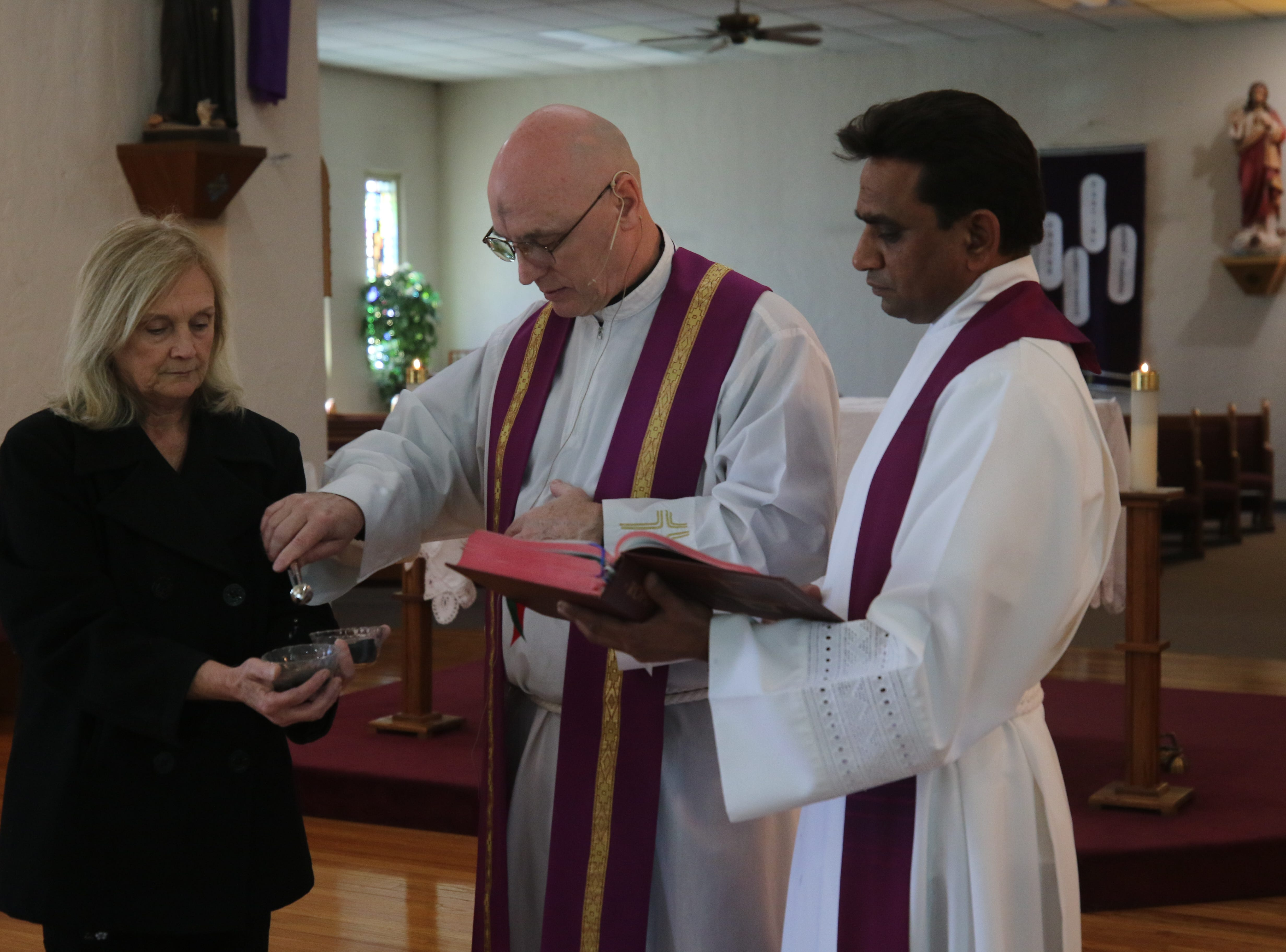 Ashes are prepared for an Ash Wednesday mass, March 6, 2019 at St Edward Catholic Church.