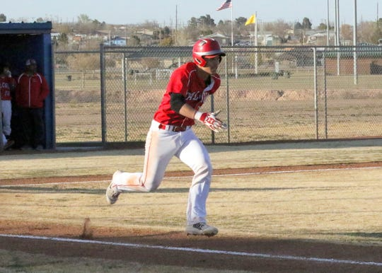Loving's Kevin Gut-omen runs to first base after connecting with a pitch against Carlsbad's C-Team on March 5.