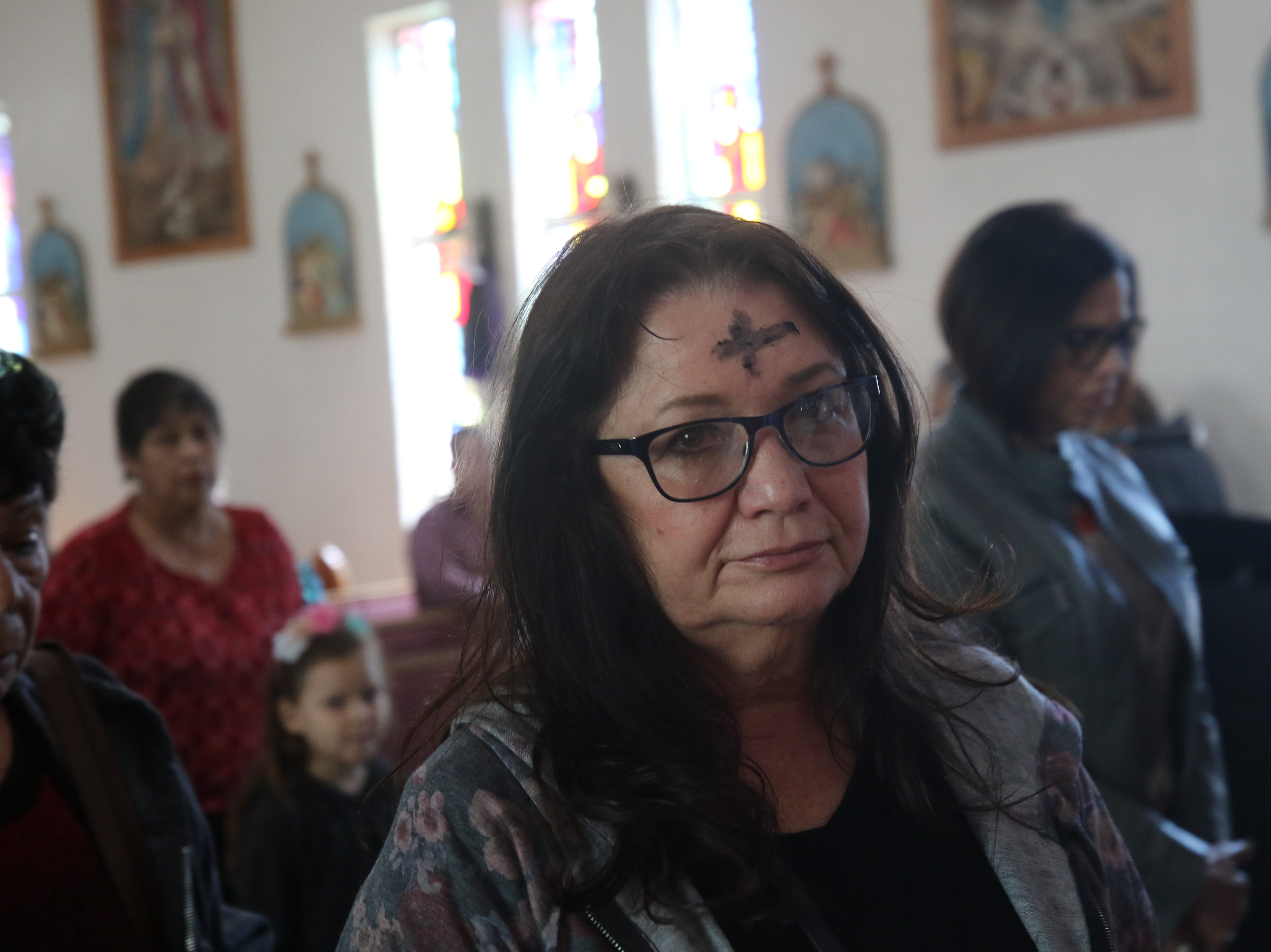 Carlsbad residents attend an Ash Wednesday mass, March 6, 2019 at St Edward Catholic Church.