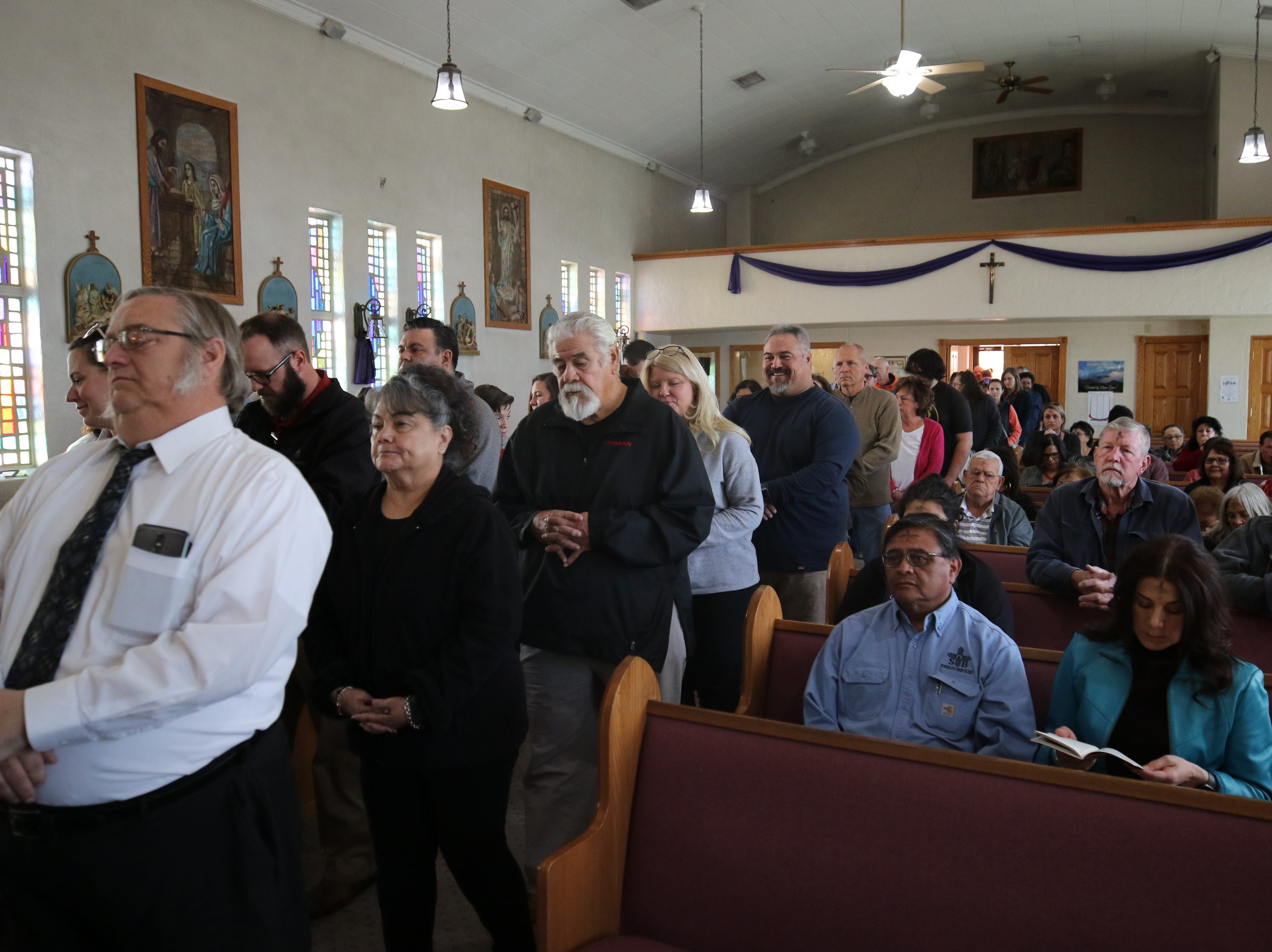Attendees line up to get their ashes at an Ash Wednesday mass, March 6, 2019 at St Edward Catholic Church.