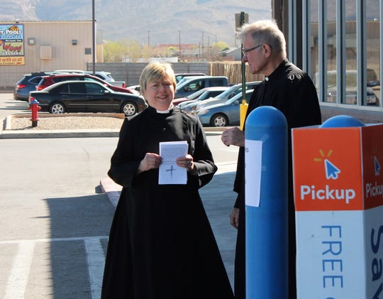 Deacon Laurie Benavidez of St. John's Episcopal Church and Pastor Mike Degner of Our Savior Lutheran Church stand outside Wal-Mart on 1st Street during the Ashes to Go ministry Wednesday morning.