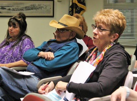 Kathy Denton of Kitty City NM, foreground, speaks at a City of Alamogordo town hall meeting to discuss changes to the animal ordinance.
